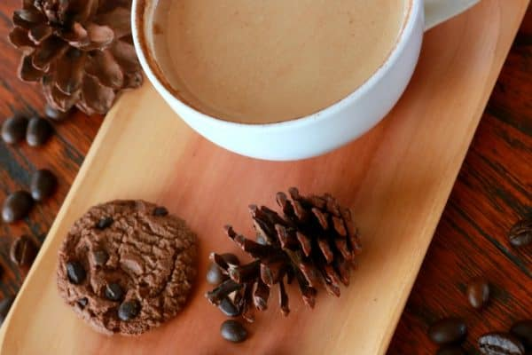 hot chocolate sitting on a table with a cookie Homemade Hot Chocolate Recipe
