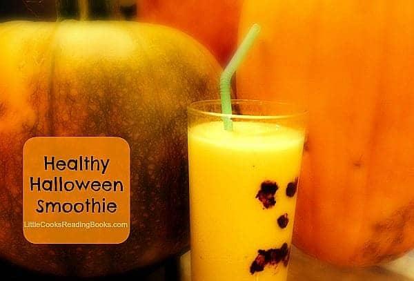 Halloween smoothie ideas Halloween pumpkin face smoothie in front of big pumpkins