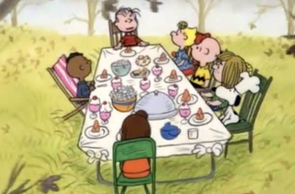 How to Host a Charlie Brown Thanksgiving Dinner Party cartoon movie scene of Peanuts Charlie Brown gang sitting at Thanksgiving dinner table