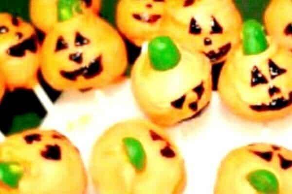 how to make pumpkin shaped cake pops with orange jack o lantern cake pops in a dish