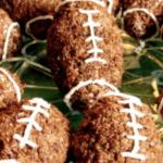 Football Chocolate Rice Krispie Treats rice crispy treats shaped like footballs on a plate