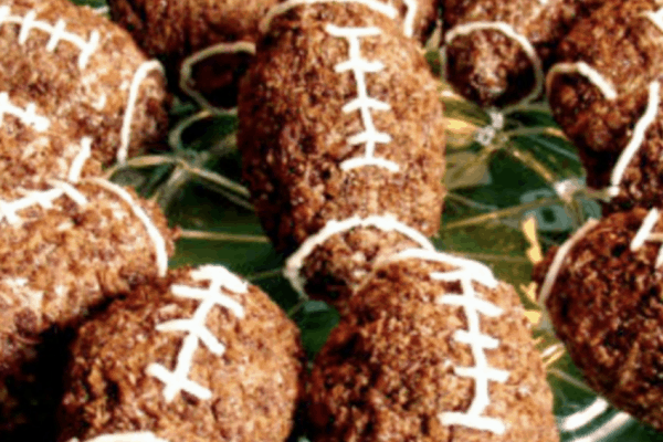 Football Chocolate Rice Krispie Treats rice crispy treats shaped like footballs on a plate