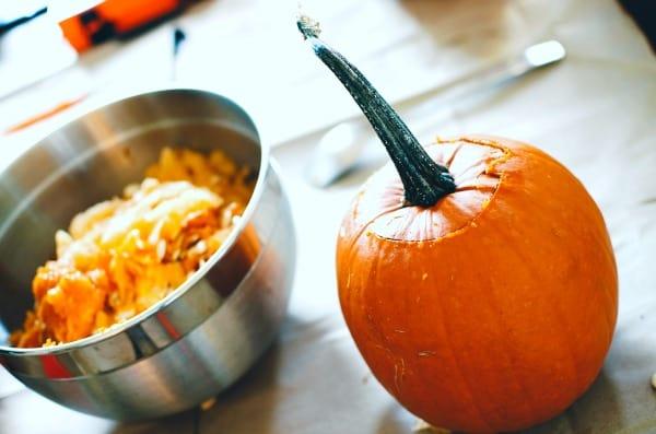 Pumpkin Seeds Recipe Ideas pumpkin with a bowl of pumpkin seeds on a table