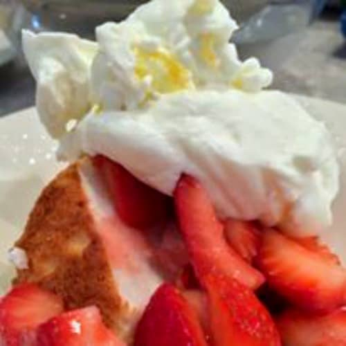 Homemade Whipped Cream Recipe (Plus a Secret Recipe Ingredient) homemade whipped cream on strawberries