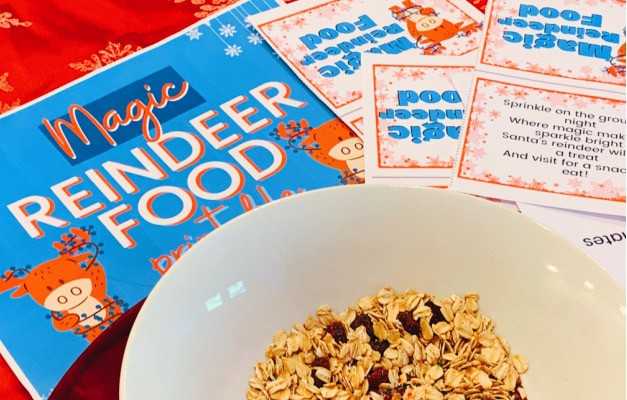 recipe for reindeer mix with reindeer food printable sitting on a red christmas tablecloth