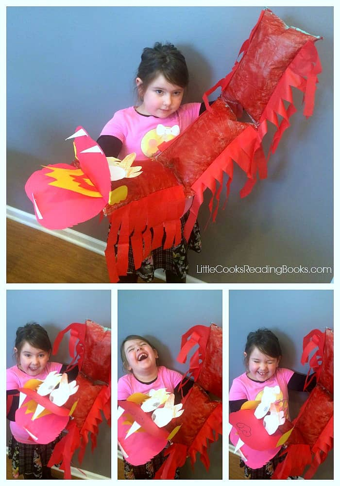 4 picture collage of a little girl holding a DIY chinese dragon craft and laughing with different faces in each picture