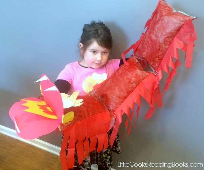 little girl holding a DIY easy chinese dragon craft
