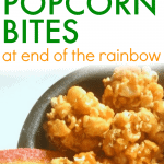 St. Patrick's Day Snacks: Pot-O-Gold Popcorn Bites text over a black bowl filled with caramel corn popcorn bites with a rainbow tape candy sticking out of the side