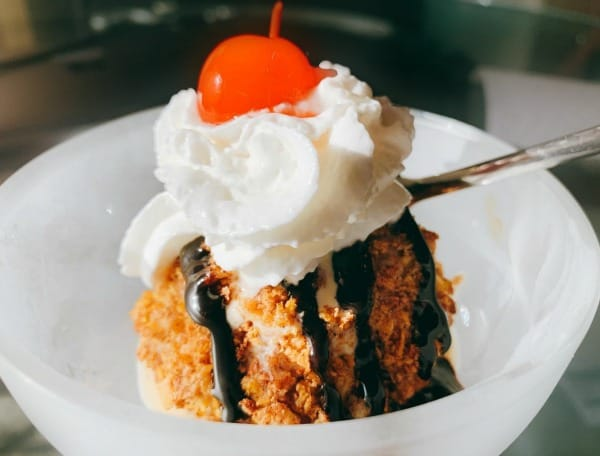 Recipe For Fried Ice Cream fried ice cream with chocolate syrup drizzled over it and whipped cream with a cherry