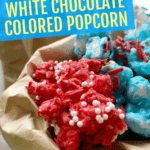 white chocolate covered popcorn in red white and blue colors in a brown paper bag
