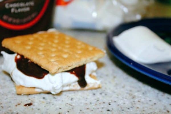 smores on a counter with marshmallow and chocolate dripping down