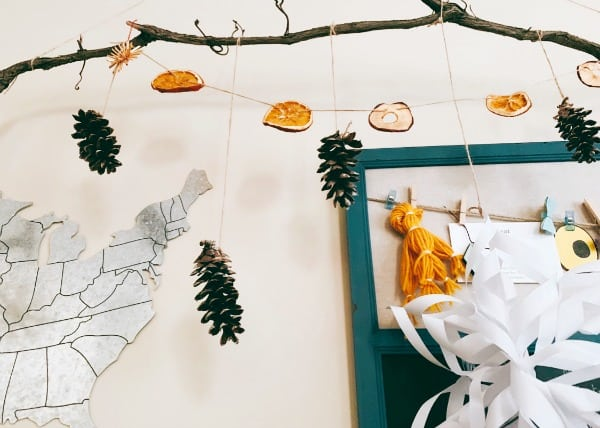 nature garland with dried oranges, dried apples and pinecones on natural twine