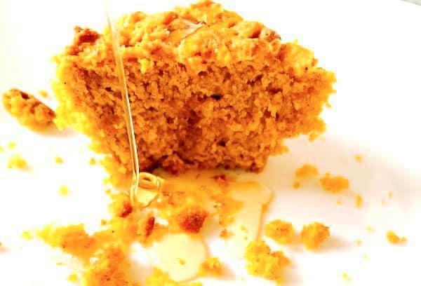 Cornbread Pumpkin Recipe on a white plate with honey drizzle