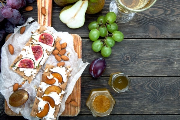 Bethlehem Dinner with figs, feta, unleavened bread, honey, grapes and pears on cheese board