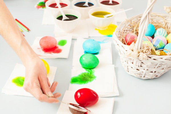 How To Dye Easter Eggs With Food Coloring colored eggs draining on paper towels