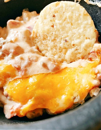 Recipe for Cheese Dip tortilla chip in sausage cheese dip