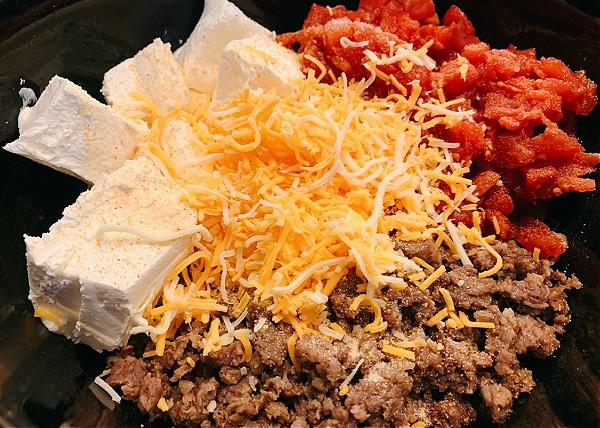 cheese dip with sausage ingredients in a slow cooker