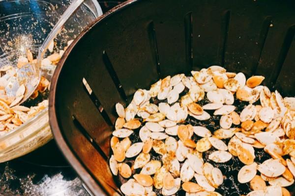 Air Fried Pumpkin Seeds in air fryer basket