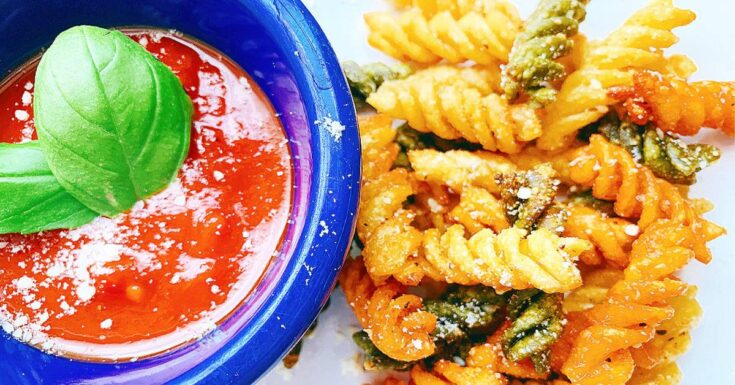 air fryer pasta snack on a plate with marinara sauce in a blue dipping dish