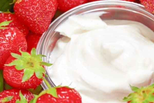 Dip Recipe For Fruit strawberries next to a bowl of fruit dip