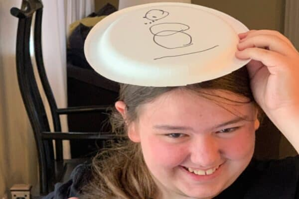 Snowman Paper Plate Game with teen girl laughing